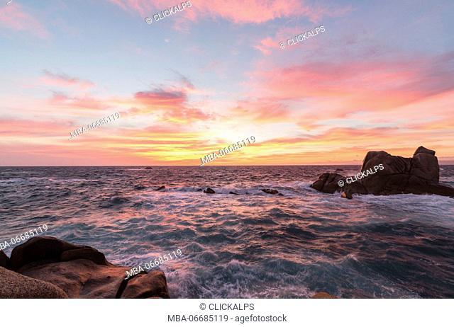 Pink sky at sunset on the waves crashing on cliffs Capo Testa Santa Teresa di Gallura Province of Sassari Sardinia Italy Europe