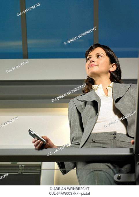 Businesswoman standing on balcony