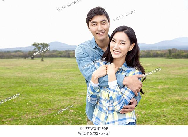 Couple together at green field