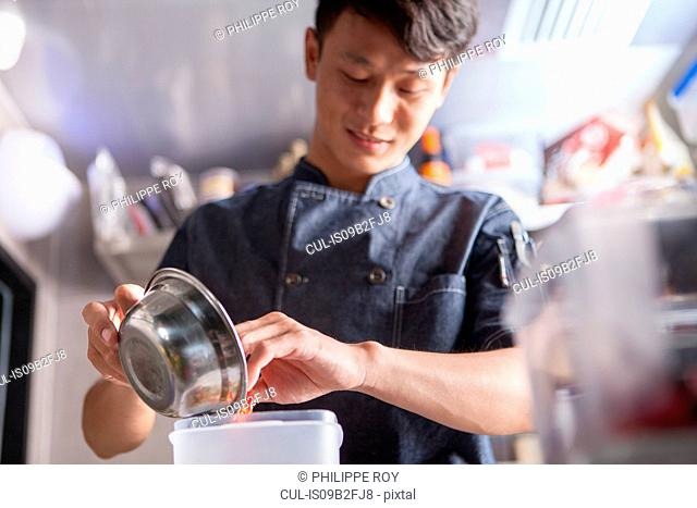 Chef in commercial kitchen preparing food