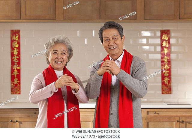 Chinese old couple celebrate the Spring Festival