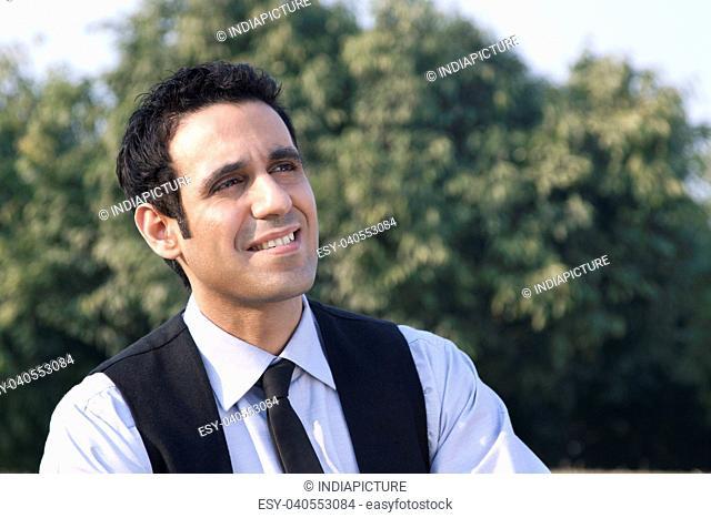Businessman smiling , INDIA , DELHI