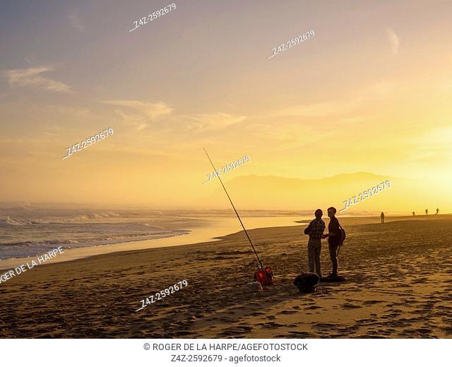 Beach scene and fishermen. Sedgefield. Garden Route. Western Cape. South Africa