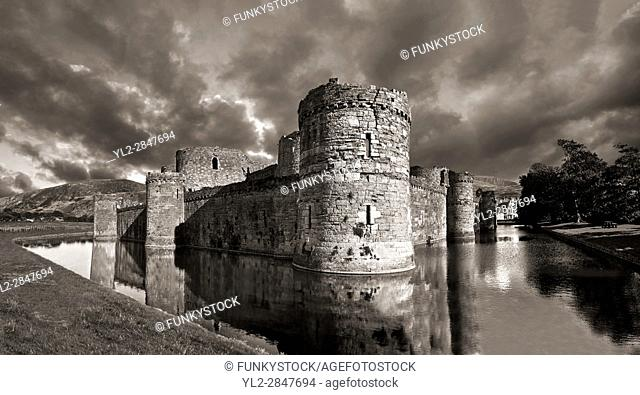 Beaumaris Castle, looking towards Snowdonia, built in 1284 by Edward 1st, considered to be one of the finest example of 13th century military architecture by...