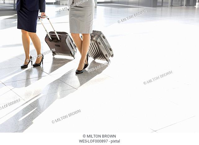 Low section of businesswomen walking at the airport