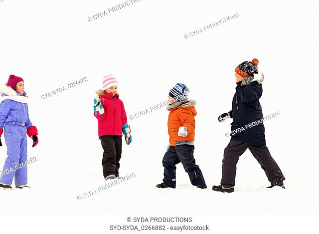 happy little kids playing outdoors in winter