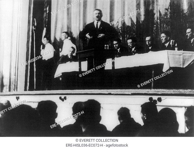 Adolf Hitler, speaking from a stage with audience in foreground. May 2, 1931. (BSLOC-2013-9-154)