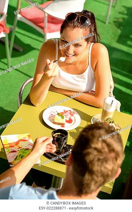 Couple enjoy coffee dessert restaurant terrace