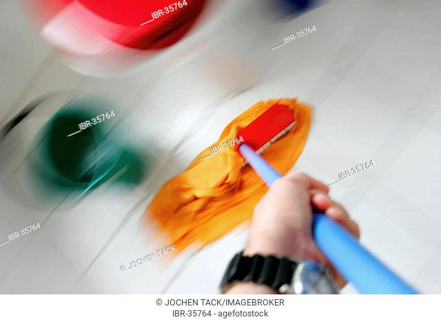 DEU, Germany : Housecleaning in a private house/apartment. Cleaning in the bathroom. Wiping the floor