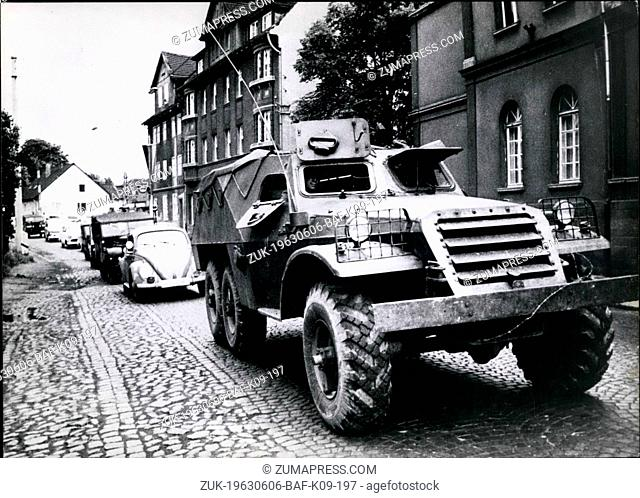Jun. 06, 1963 - East german soldiers flee to west in armored patrol car: Three soldiers of communist east german army broke through the barbed wire frontier at...