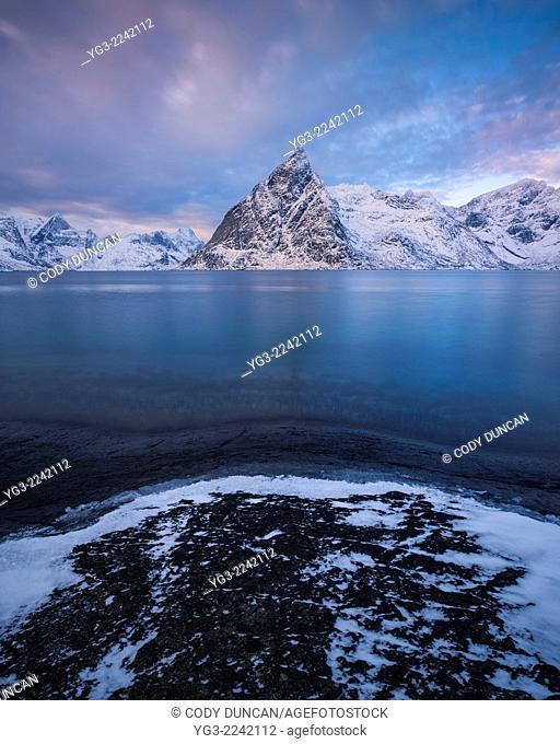 Winter view over Olstind mountain peak, Toppøy, Lofoten Islands, Norway