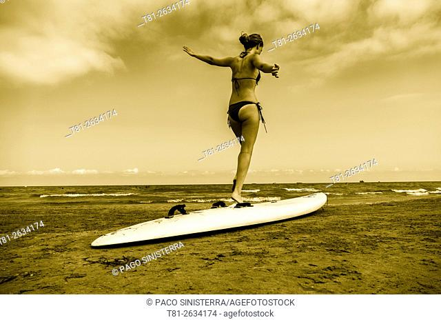 Surfboard girl in Benicasim, Castellon, Spain
