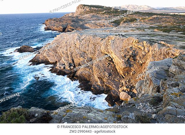 Mediterranean sea coast at sunset. La Pelosa, Sardinia. Italy