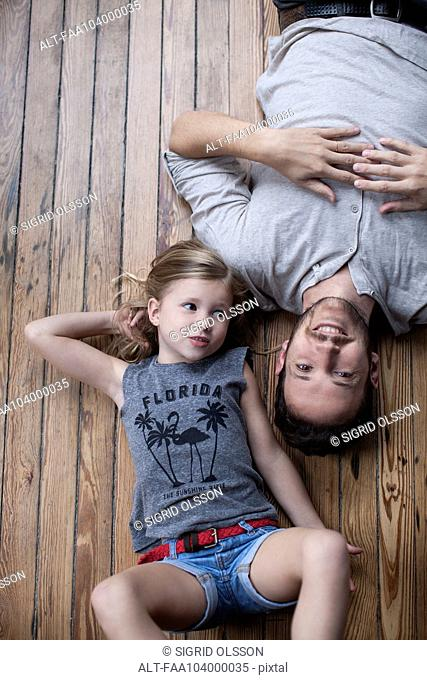 Little girl and father hanging out together