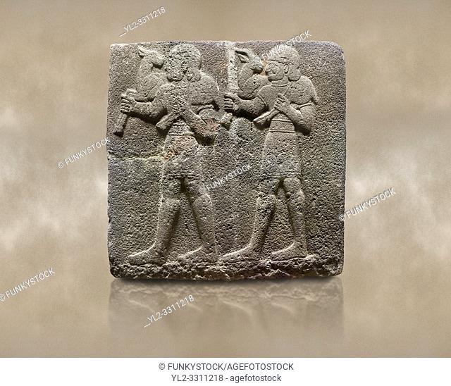 Photo of Hittite monumental relief sculpted orthostat stone panel of a Procession Basalt, Karkamıs, (Kargamıs), Carchemish (Karkemish), 900-700 B. C