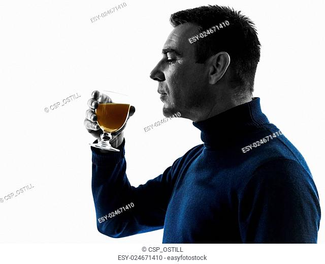 man drinking orange juice silhouette portrait