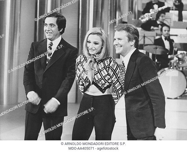 Raffaella Carrà, Alighiero Noschese and Corrado in Canzonissima. Italian TV host, actress, singer and showgirl Raffaella Carrà (Raffaella Maria Roberta Pelloni)