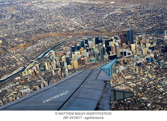 Looking down at downtown Calgary from the window of a plane