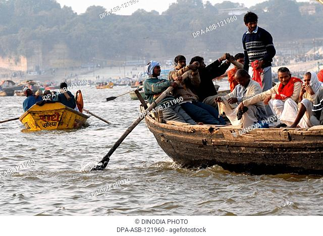 Boats ferry devotees at the confluence of the Ganges , Yamuna the mythical Saraswati rivers to take a holy dip during the Ardh Kumbh Mela , , , India