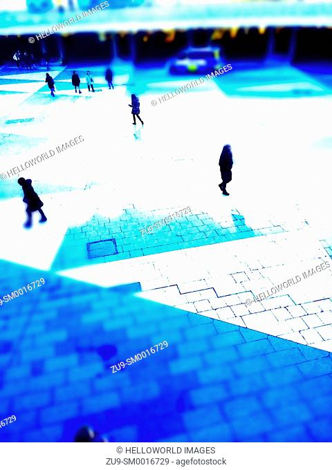 Commuters rushing across pedestrian plaza, Sergels Torg, Stockholm, Sweden, Scandinavia