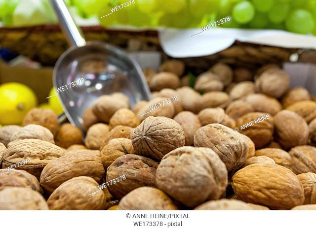 Bushel of walnuts at a fruit stand in Market Hall Cagliari, Sardinia, Italy