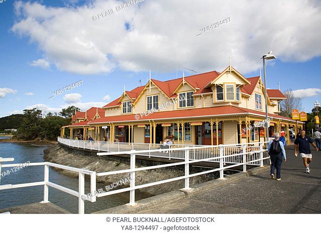 Paihia Bay of Islands Northland North Island New Zealand  Maritime building for tourist information and travel booking on waterfront from wooden jetty to wharf