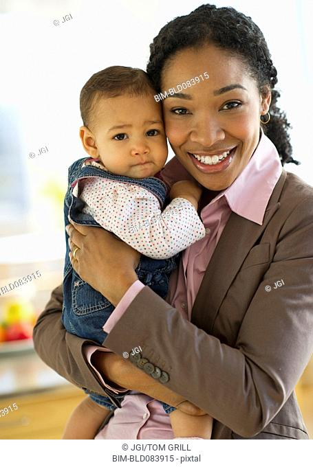 Mixed race woman holding baby