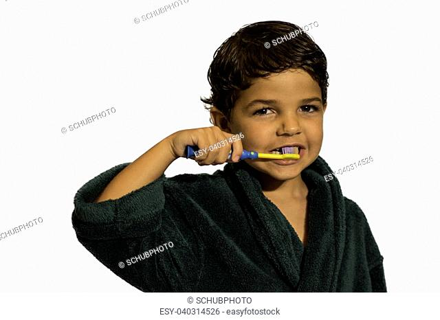 c747546e8d A Child brushing his teeth in a bathrobe on a white background