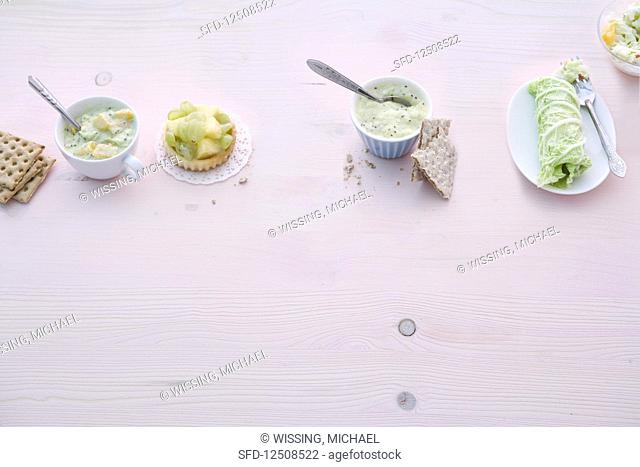 Orange and kiwi bread, fruit tartlets, kiwi and pear cream on crispbread, and fruity cabbage roulade with low fat quark