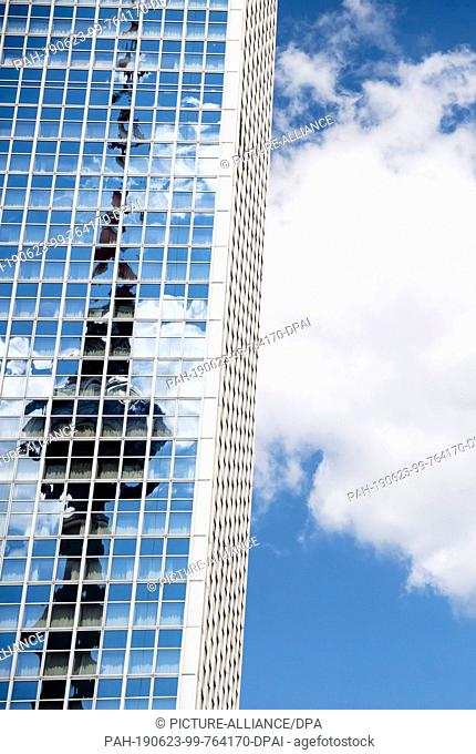 23 June 2019, Berlin: The Berlin television tower is reflected in the facade of the Park Inn Hotel on Alexanderplatz. (recrop) Photo: Christoph Soeder/dpa
