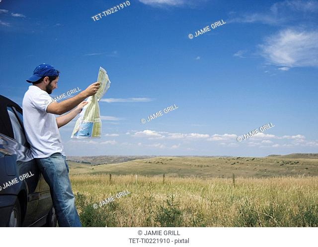 Man reading a map outdoors