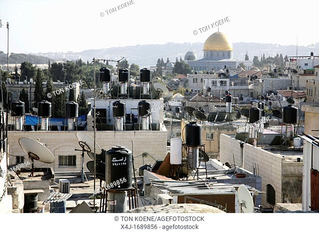 Rooftops full of chimneys and communications equipment in the old city section of Jerusalem Nearby the dome of the rock