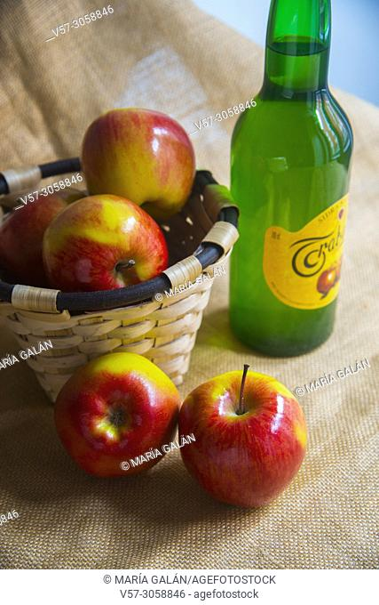 Apples and bottle of cider. Asturias, Spain