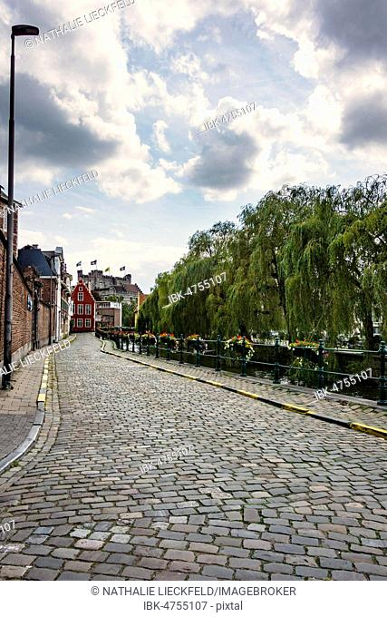 Road along the river Leie with a view of Gravensteen, Augustijnenkaai, Ghent, Belgium