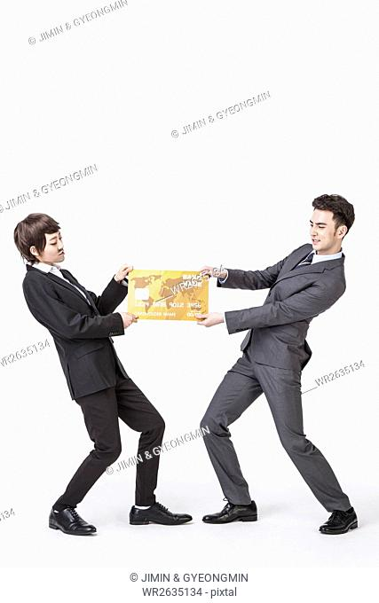 Woman disguising herself as businessman and a businessman holding and tugging a map