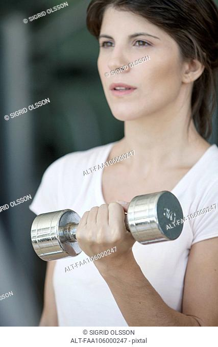 Woman lifting dumbbell