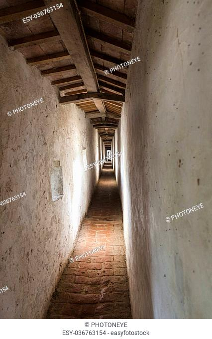 Narrow corridor in an old fortification in Italy