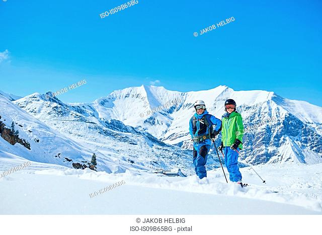 Father and son on skiing holiday, Hintertux, Tirol, Austria