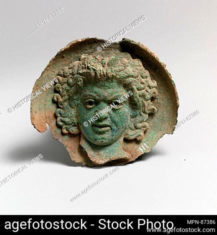 Silvered bronze roundel with satyr head (one of a pair). Period: Hellenistic; Date: ca. 325-300 B.C; Culture: Greek; Medium: Bronze; Dimensions: Diam