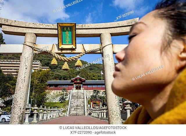 Toshogu Shrine and woman praying, Hiroshima, Japan