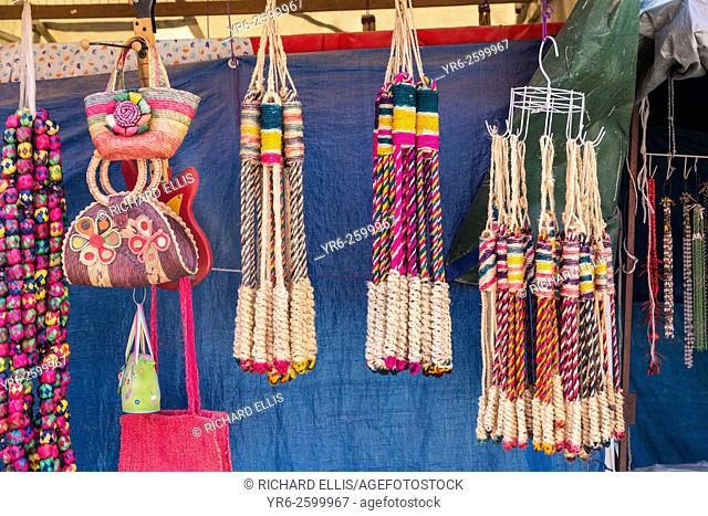 Religious icons and whips for sale at small stalls for Mexican pilgrims and penitents at the Sanctuary of Atotonilco an important Catholic shrine in Atotonilco