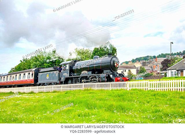 Steam train at the Bo'ness Kinneil Railway passing the fields