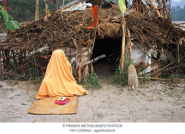 Hindu ascetic meditating in front of the place where he stays. Taraï region, Nepal