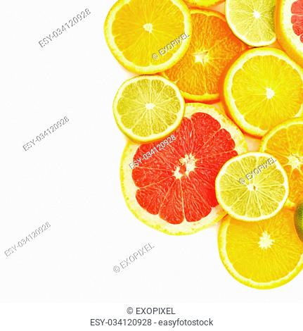 Surface covered with citrus sliced different fruits over white isolated background