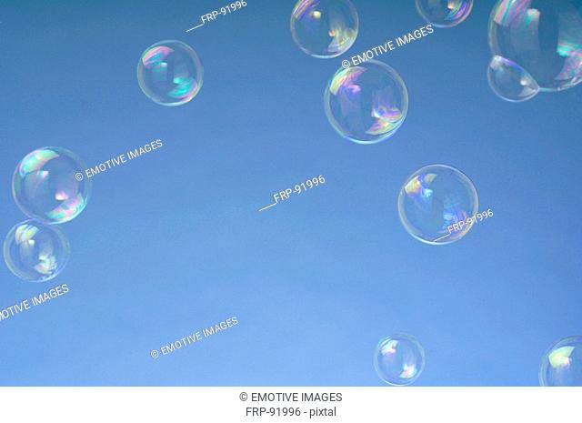Soap-bubbles in front of blue background