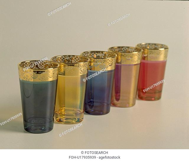 Close-up of colourful glass Moroccan tea-glasses with gold rims