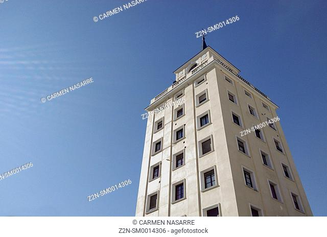 Tower with windows over blue sky