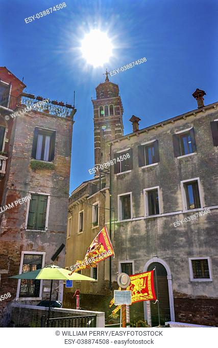 Sun Sunflare Santa Stefano Church Venetian Flags Venice Italy. Founded in the 1200s, rebuilt in 1300s