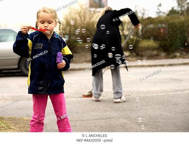 A girl with soap bubbles