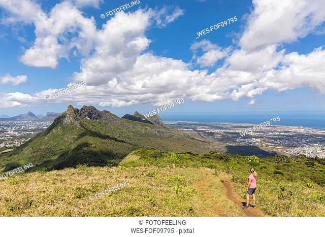 Mauritius, Le Pouce Mountain, female hiker looking to Snail Rock and Port Louis